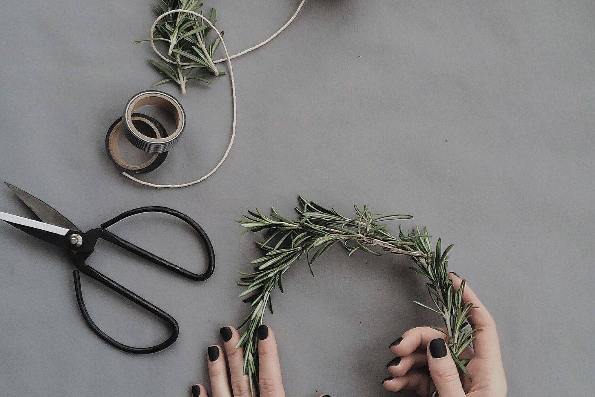 woman making a wreath out of rosemary and learning to start working from home