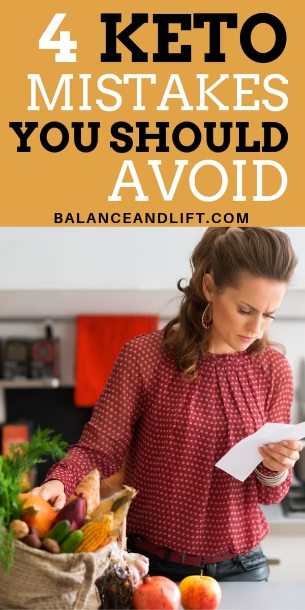 woman looking over a paper with groceries on the counter – keto mistakes