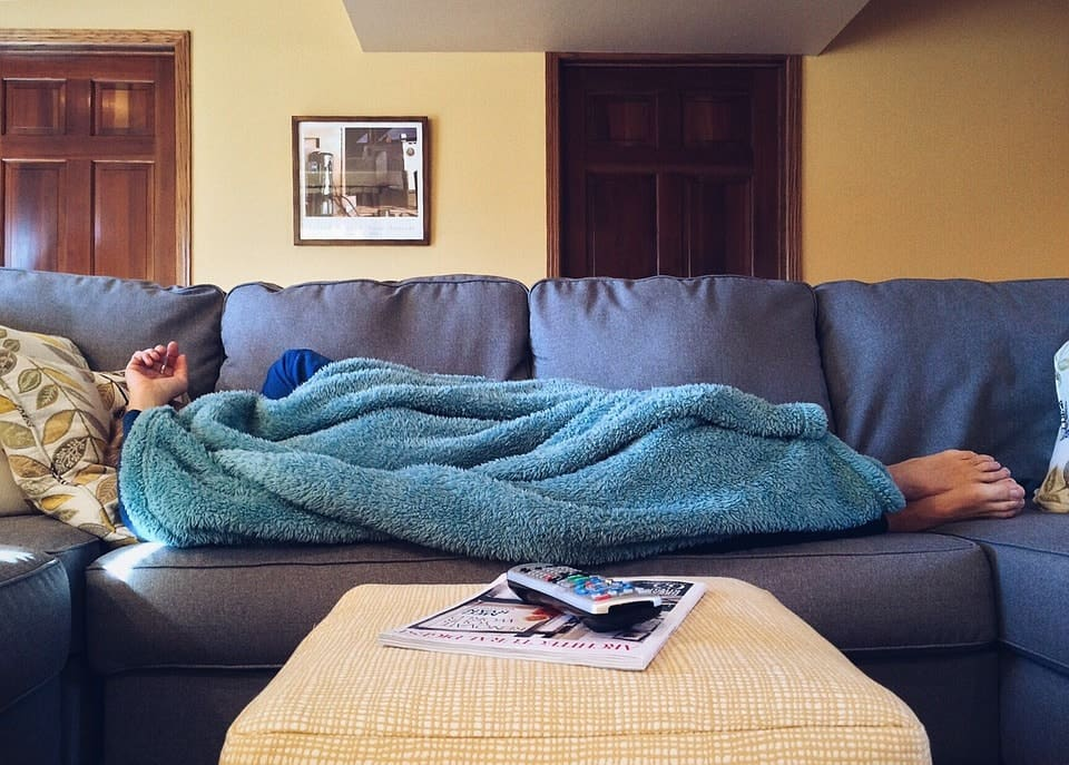 image of a person laying on a couch