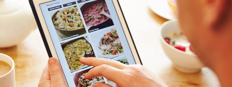 woman on a tablet looking at meal ideas
