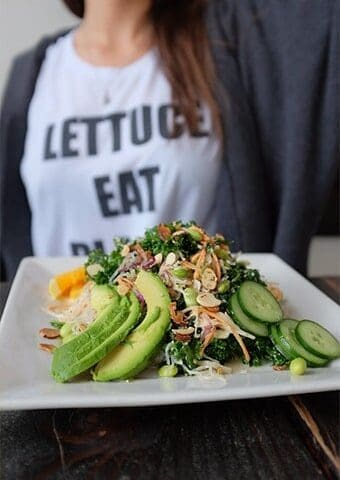 image of a girl holding a salad