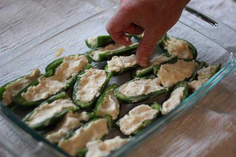 jalapeno halves stuffed with cream cheese and shredded cheese mix