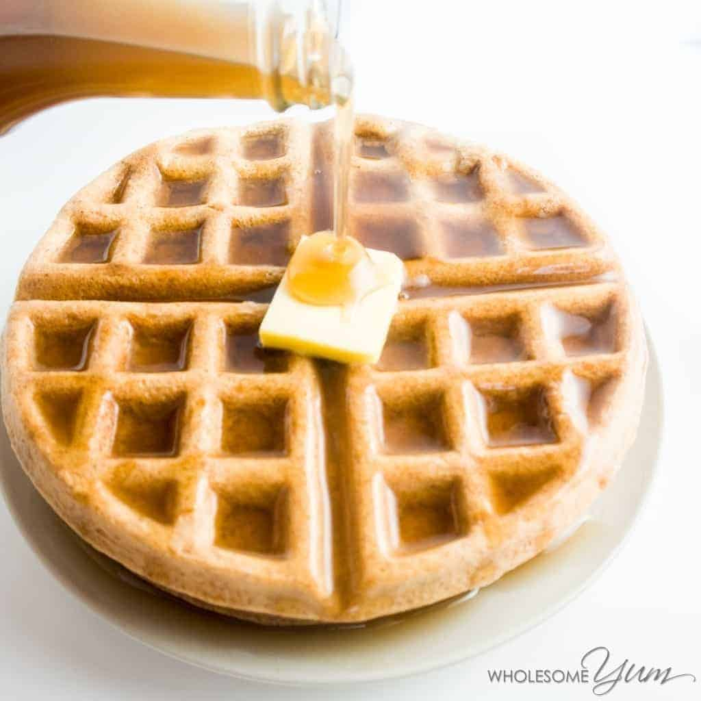 image of a keto waffle with a pad of butter and keto syrup on top