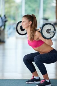 image of a woman doing barbell squats