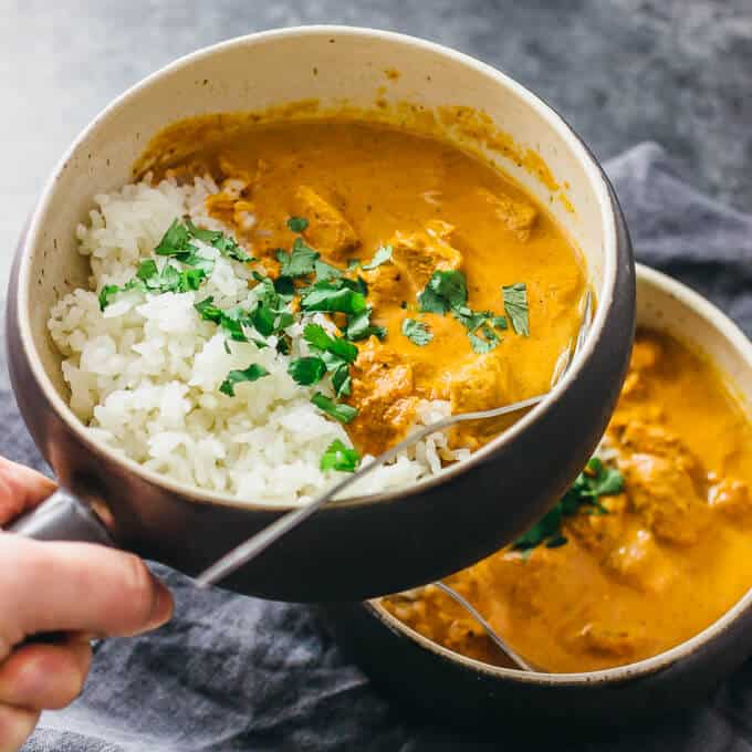 chicken tikka masala in soup bowls with rice