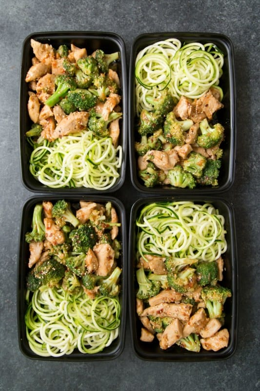 keto sesame chicken and broccoli stir fry in meal prep bowls