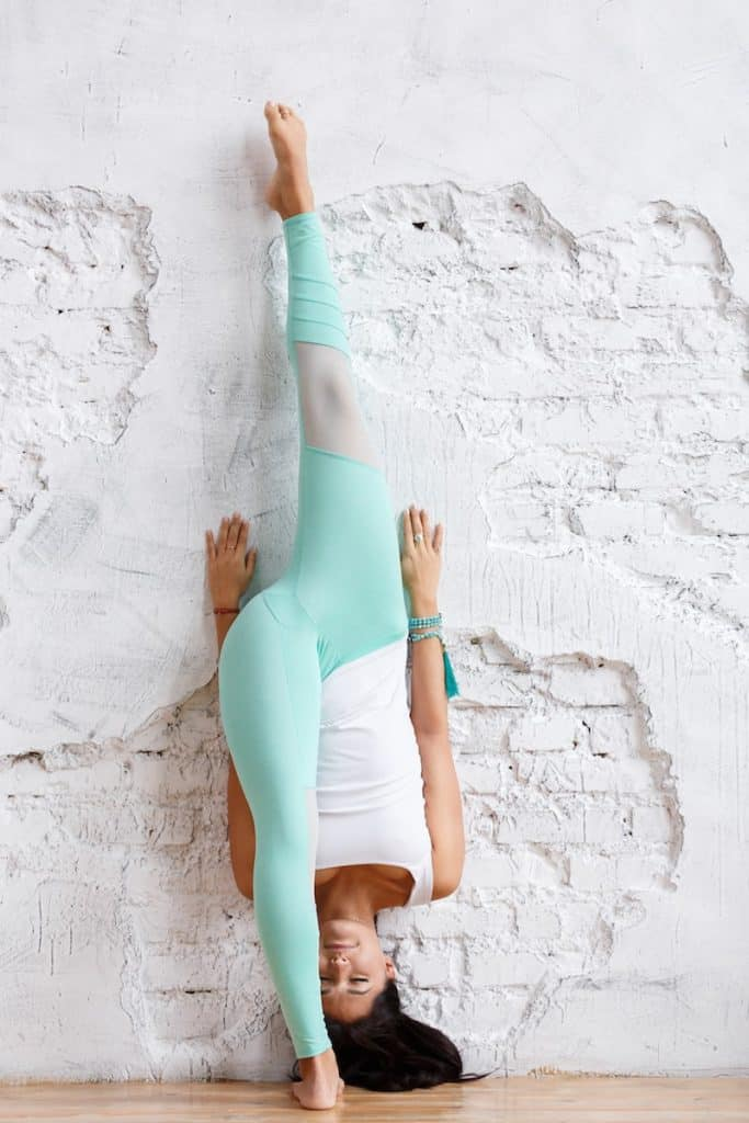 image of a woman doing a wall split