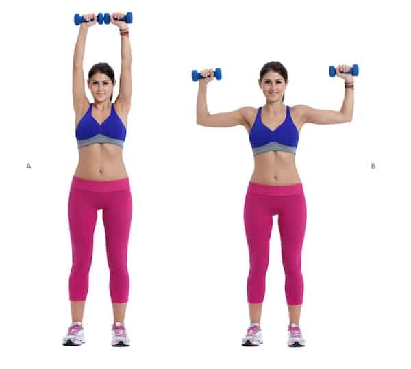 woman doing overhead press with weights