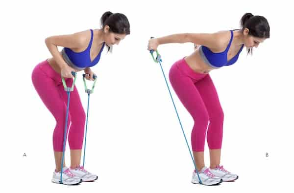woman doing bicep workout with resistance band