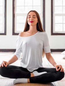 woman siting in lotus position