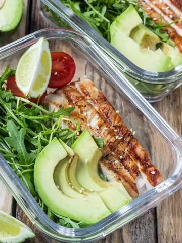 meal prep containers with chicken, avocado and salad