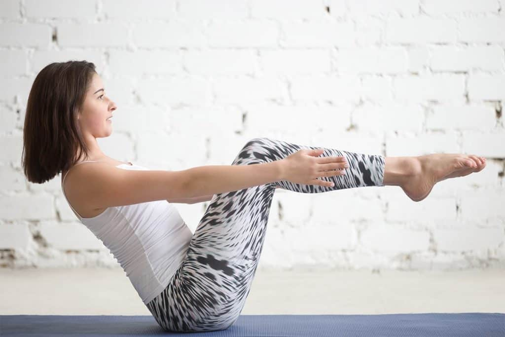 woman doing modified boat pose
