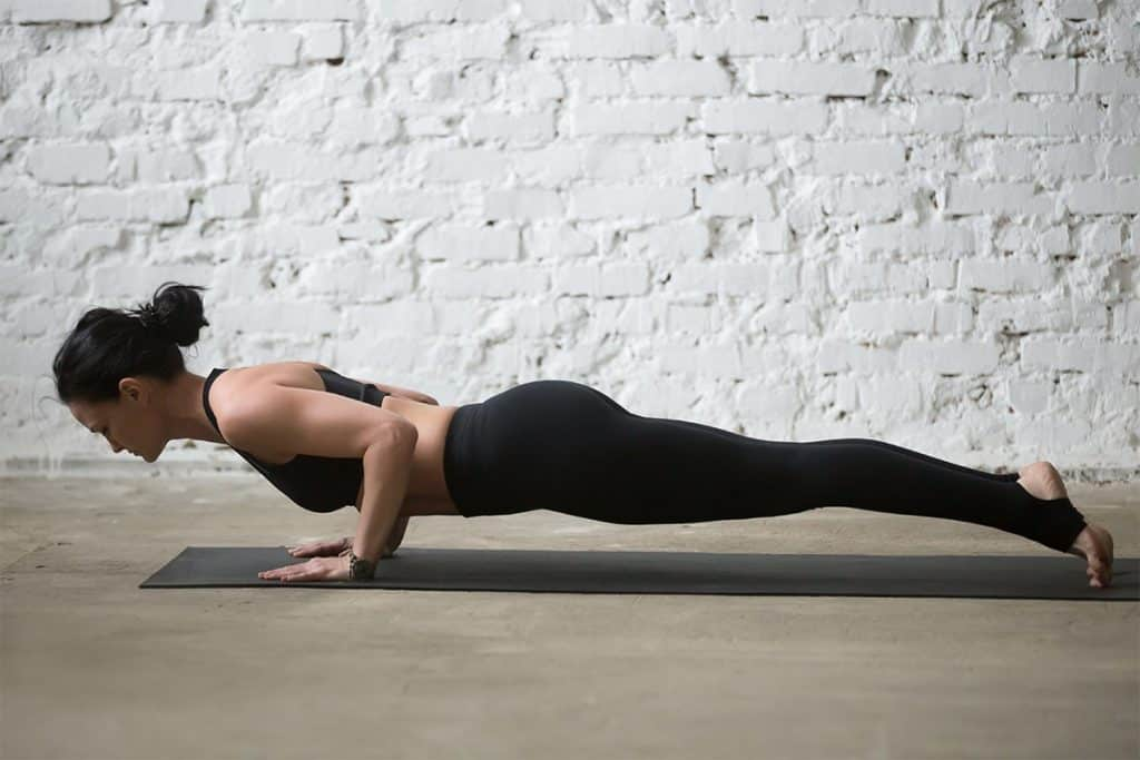 woman doing chaturanga (or four-limbed staff pose)