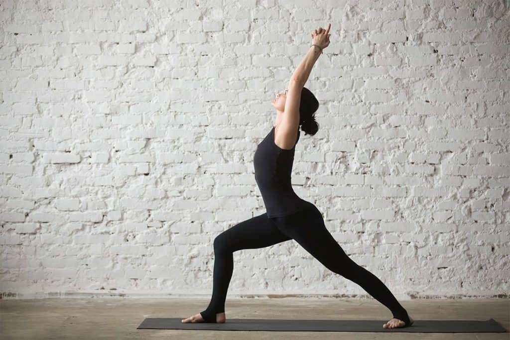 woman doing crescent pose