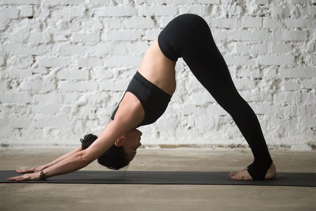woman doing downward facing dog