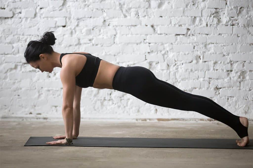 woman in high plank pose