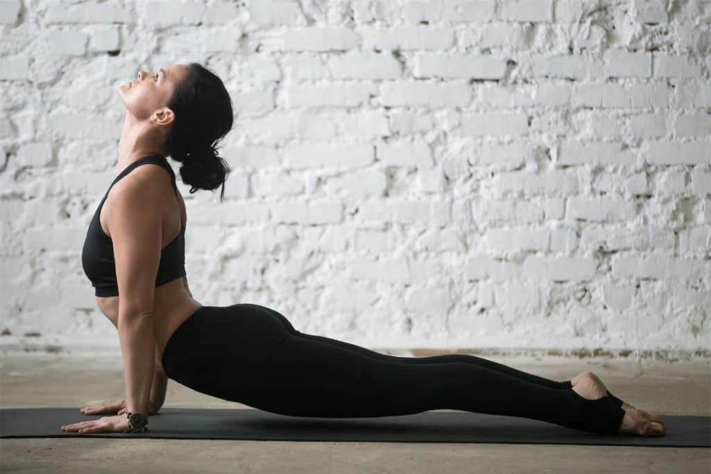 woman doing upward facing dog