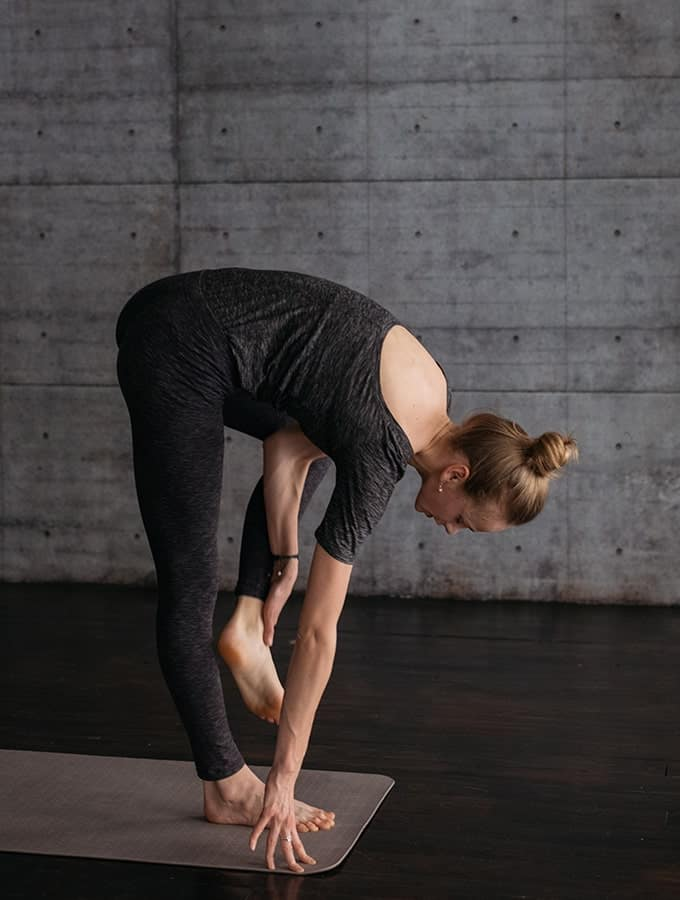woman getting into tree pose
