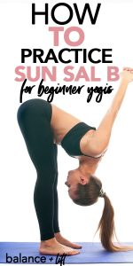 woman in forward fold with chest opener - sun salutation b