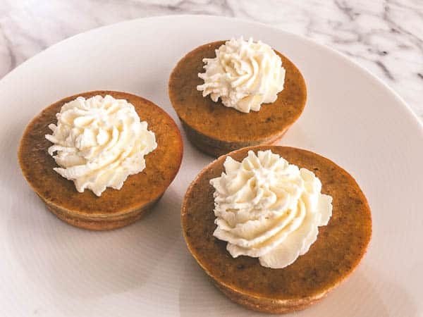 low carb pumpkin pies with whipped cream on top