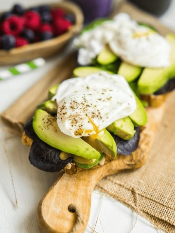 avocado toast with a poached egg on top