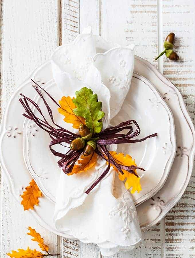 image of two plates with a thanksgiving festive napkin on top