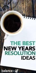 coffee cup and a pad of paper with new years resolution ideas