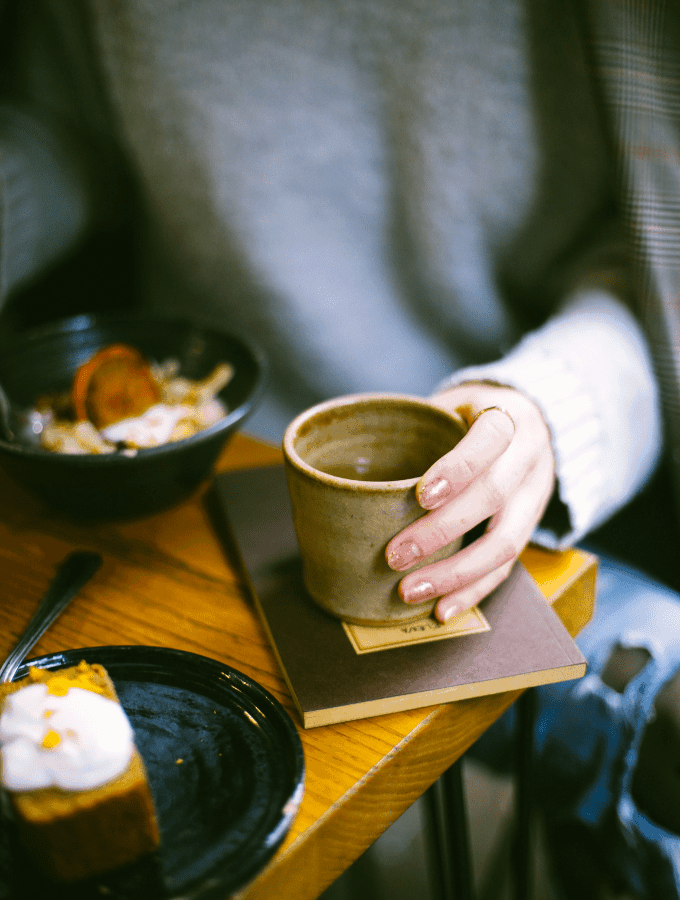 woman drinking coffee and having breakfast