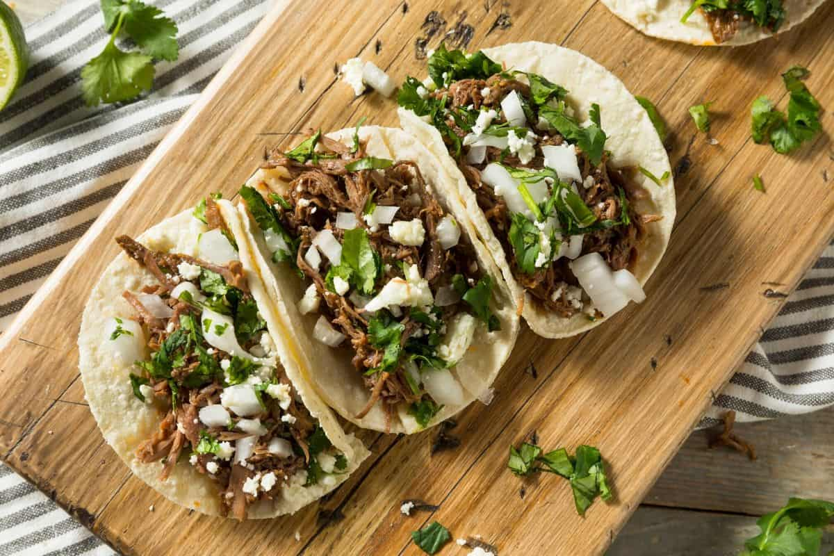 shredded tacos on a cutting board