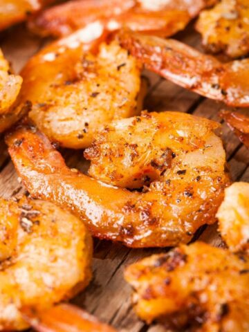 cooked shrimp on a cutting board