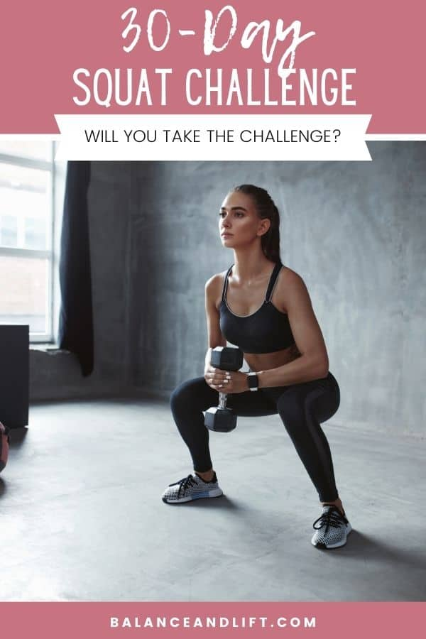 woman squatting with a dumbbell