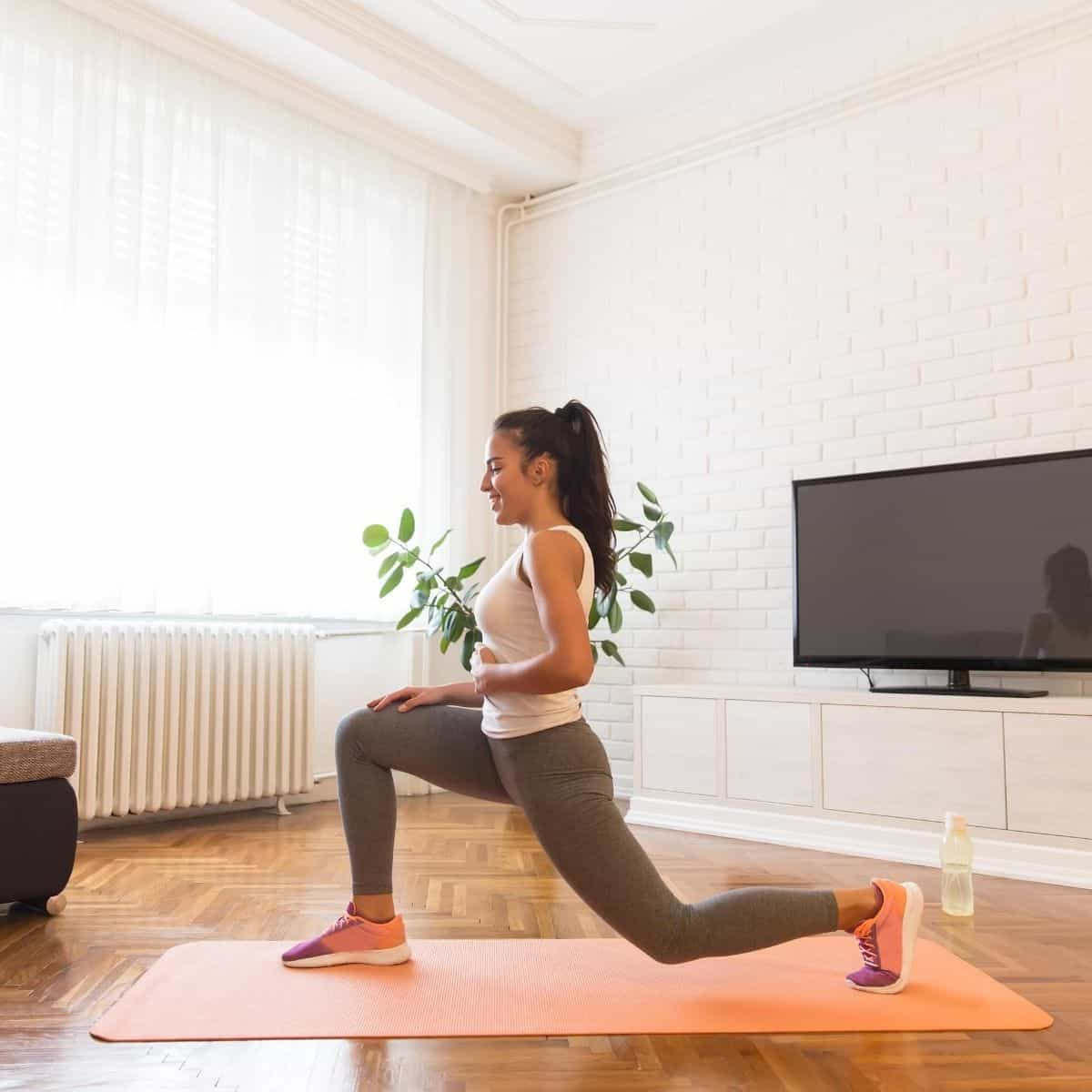 woman learning how to start working out from home