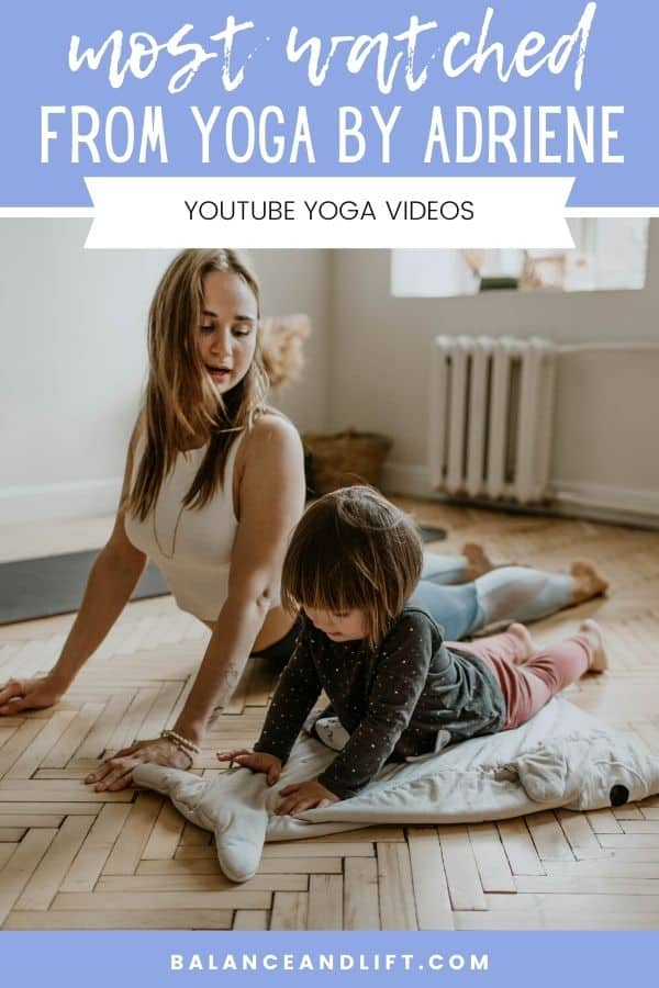 woman and daughter practicing to yoga by adriene videos