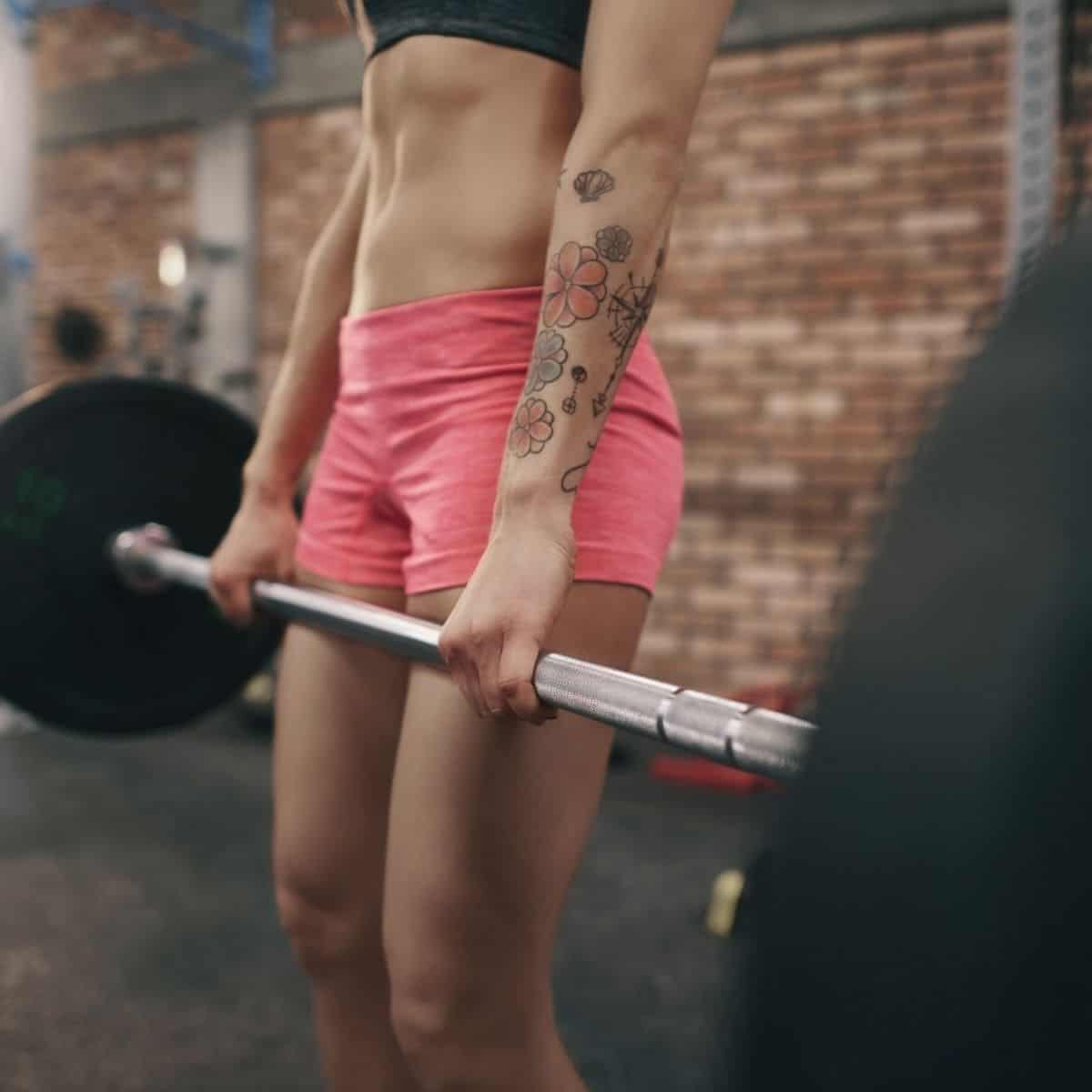 woman holding a barbell