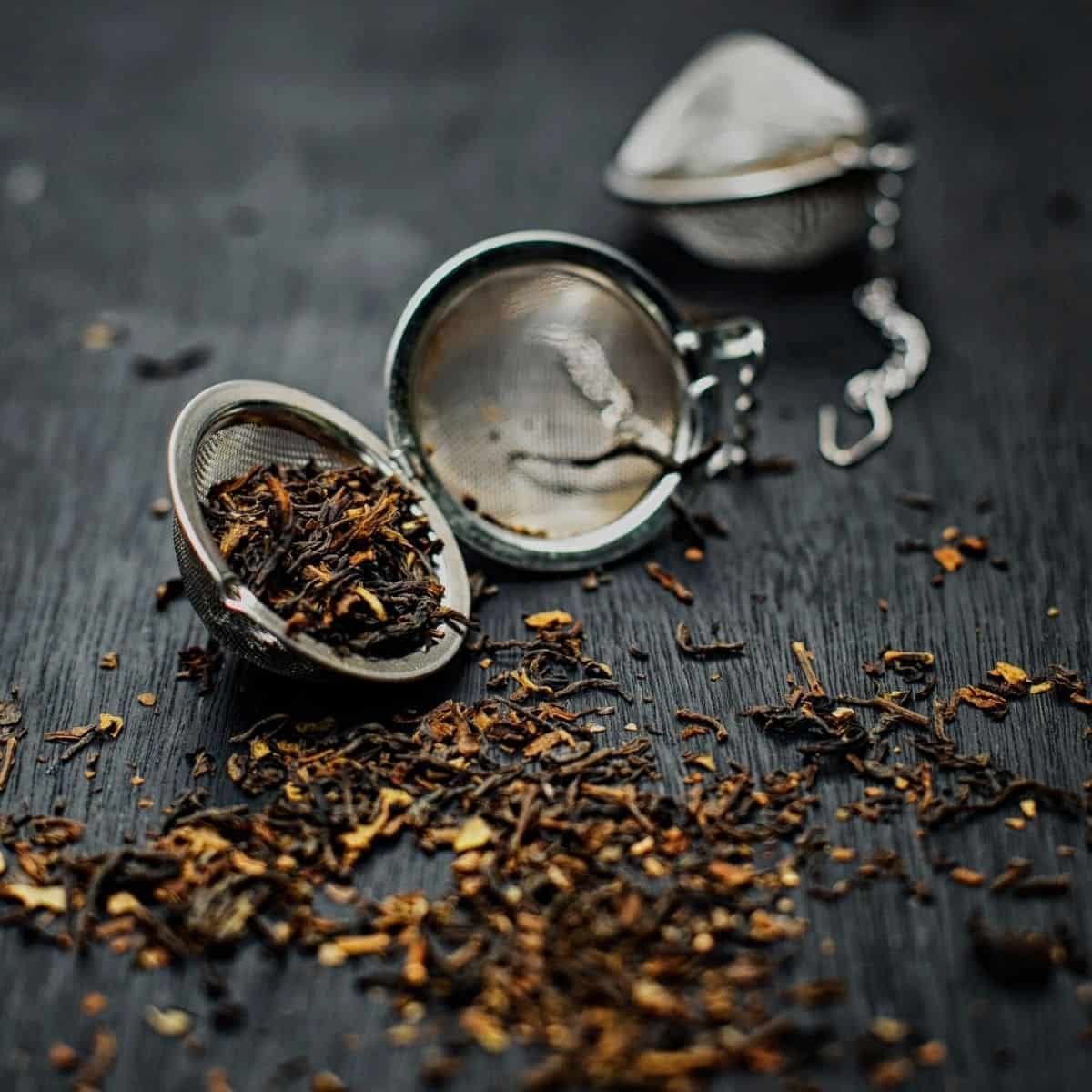 tea strainer with herbs falling out