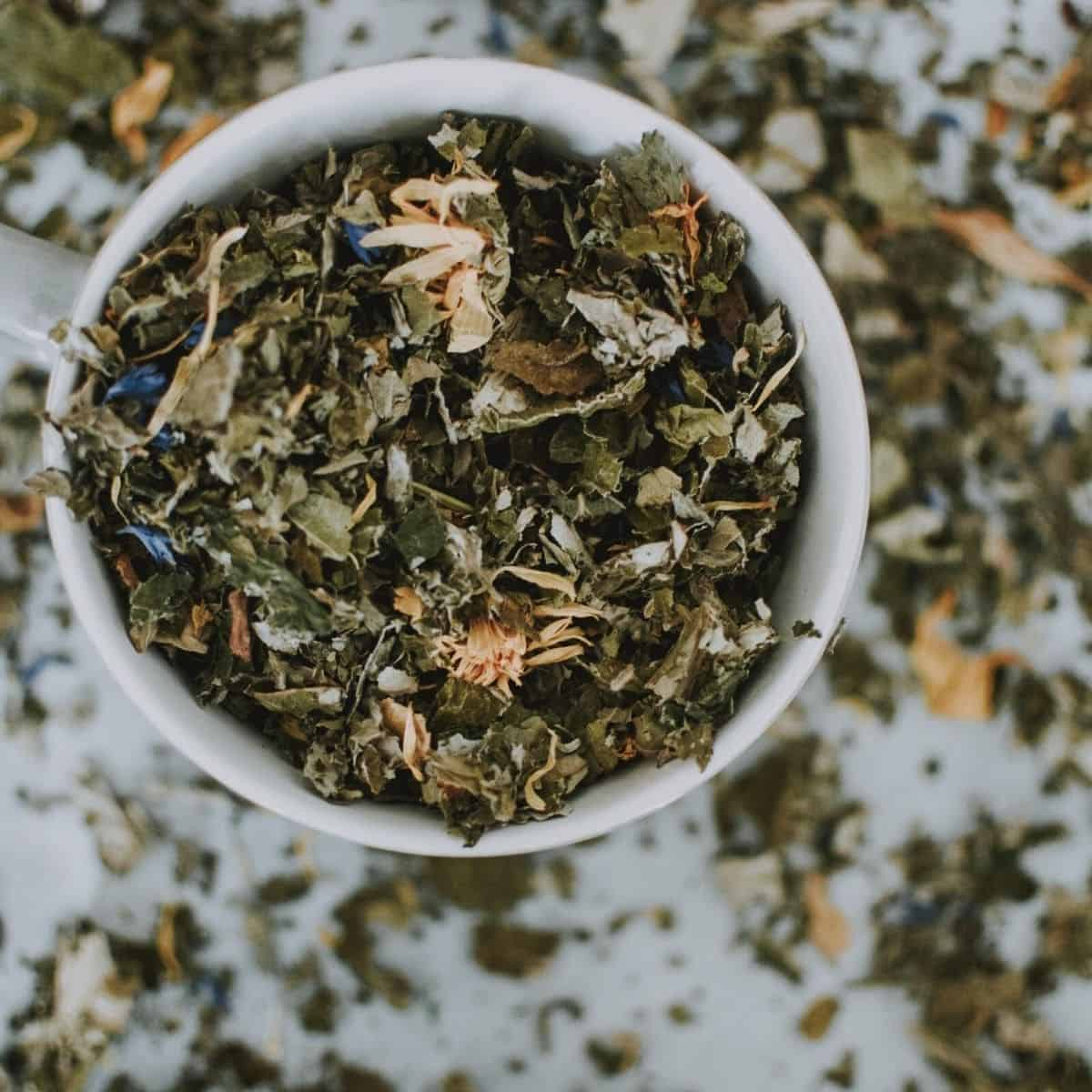 herbs for hormones in a cup on a counter