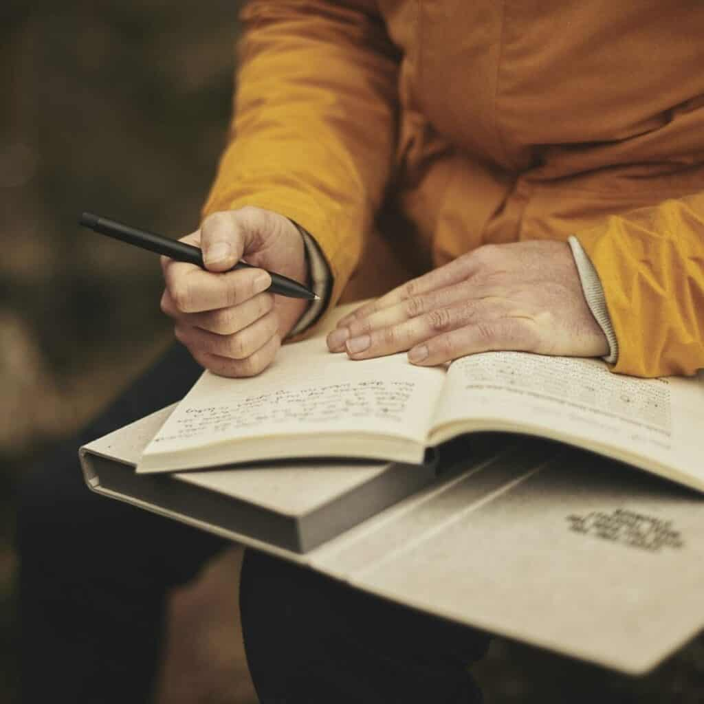 elderly woman journaling affirmations for strength