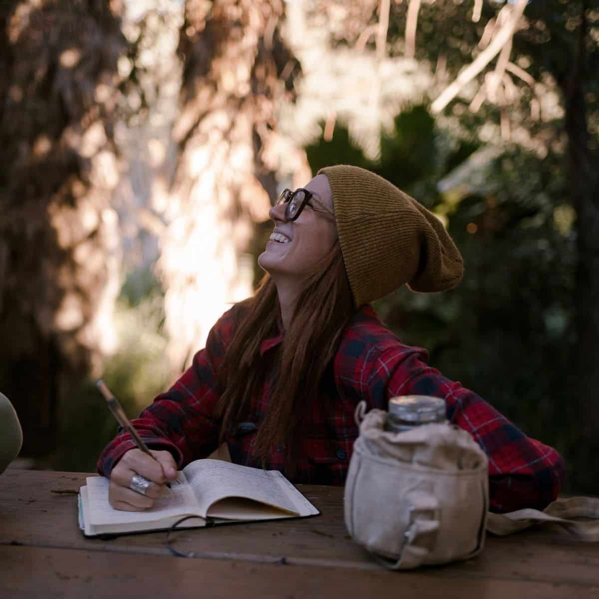woman journaling affirmations for strength
