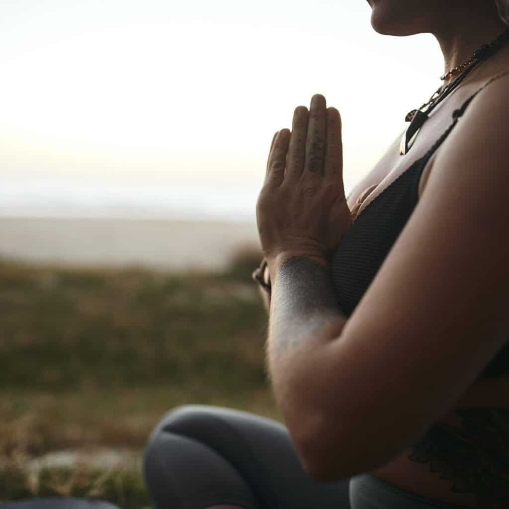 woman with her hands in namaste prayer pose