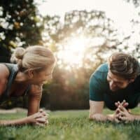 couple completing a crossfit bootcamp workout